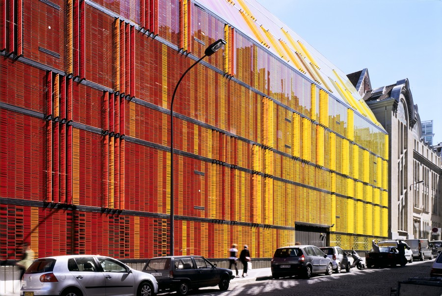 Colorful Painted Glass Facade Contrasts Classical Architecture