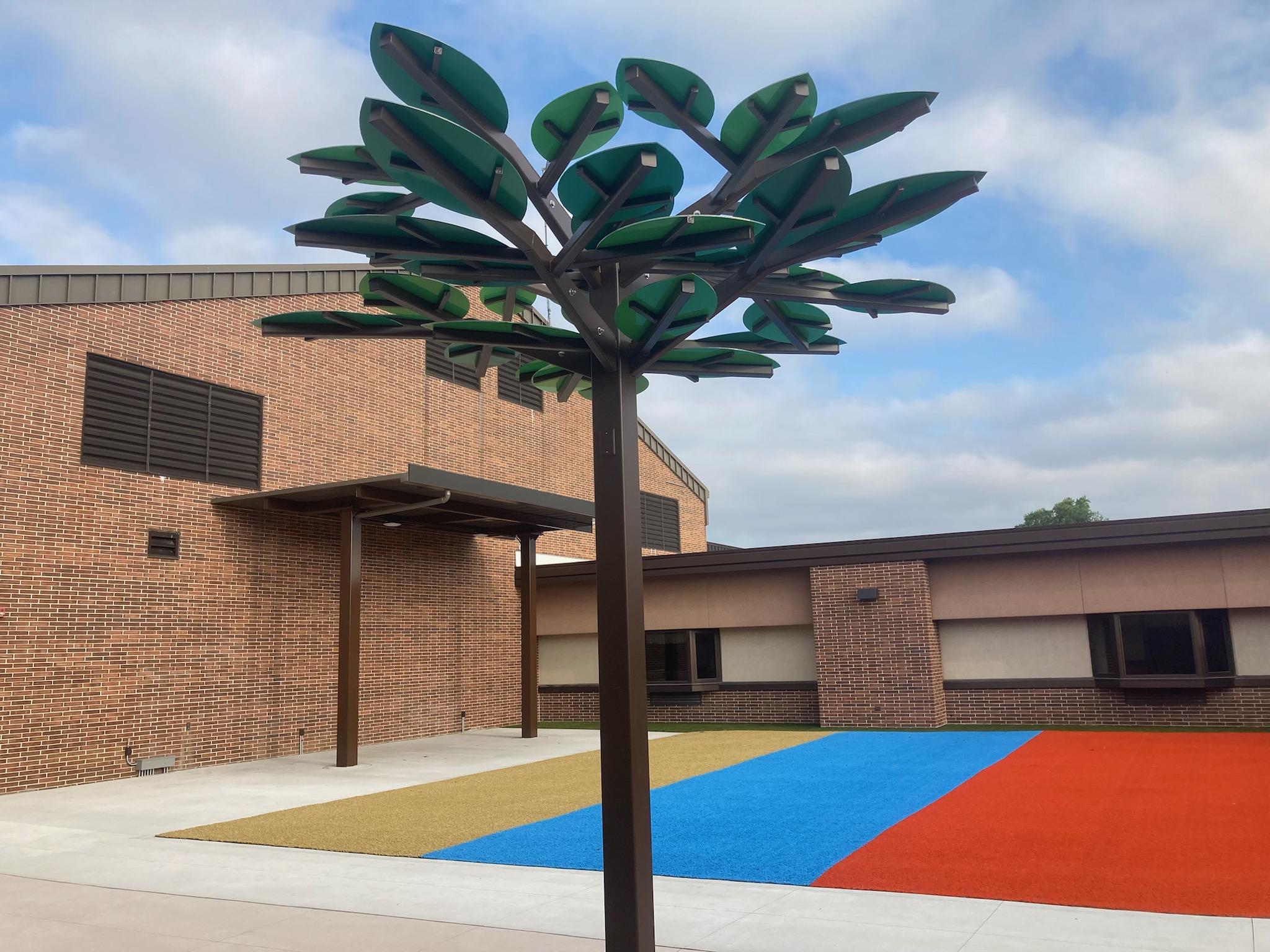 ALPOLIC MCM Leaves Provide Shade in Elementary School Courtyard